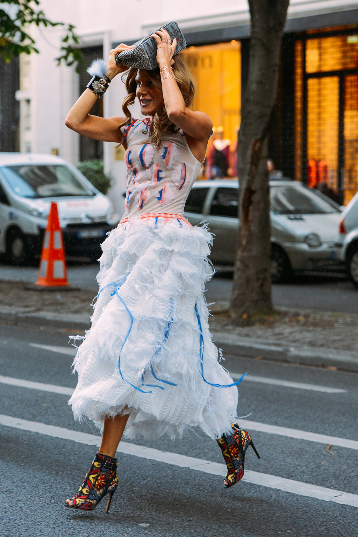 Anna Dello Russo stepped out in an unraveling feathery dress.