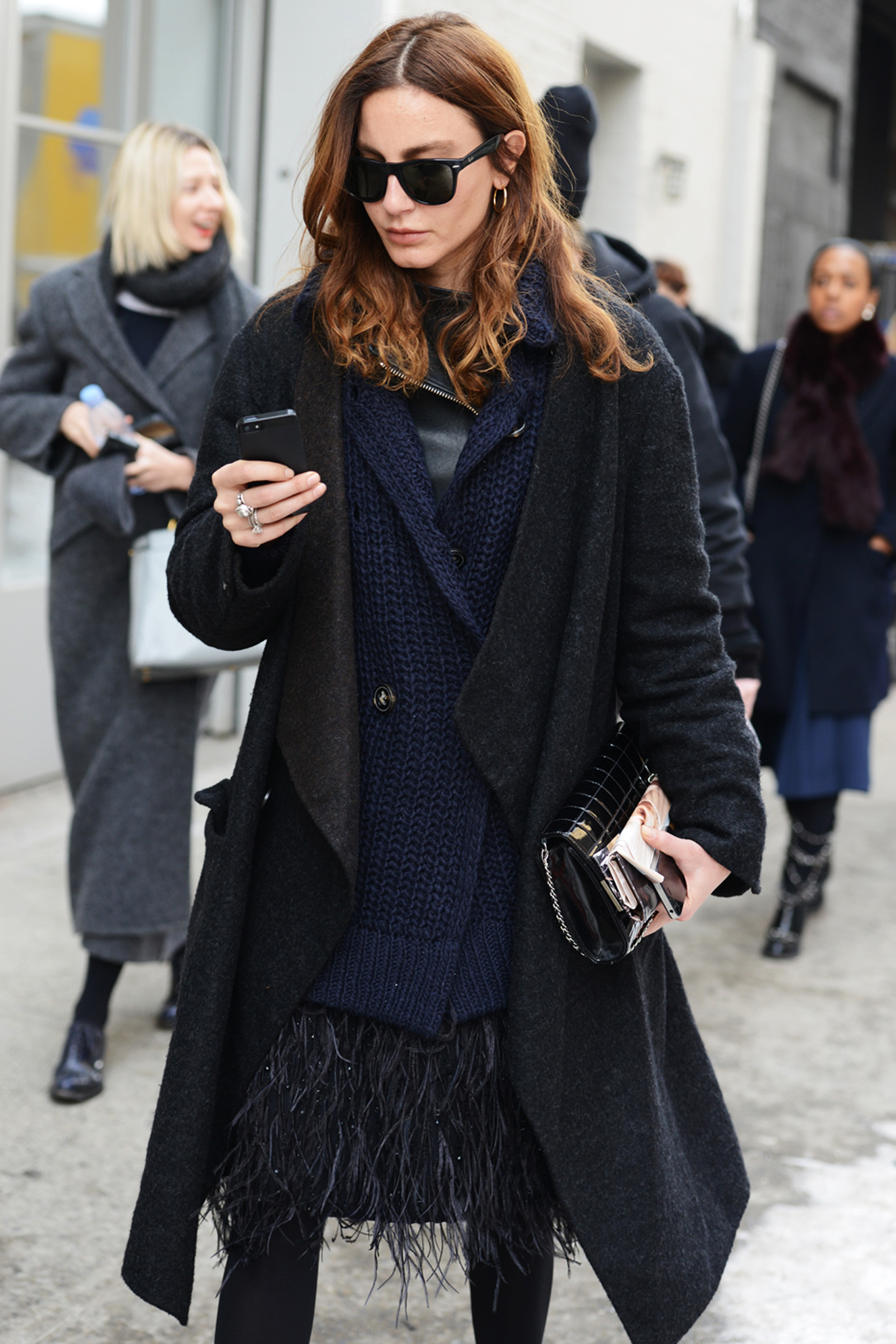 Ece Sukan mixed her feathered skirt with other textures, like a thick knit and fuzzy coat.